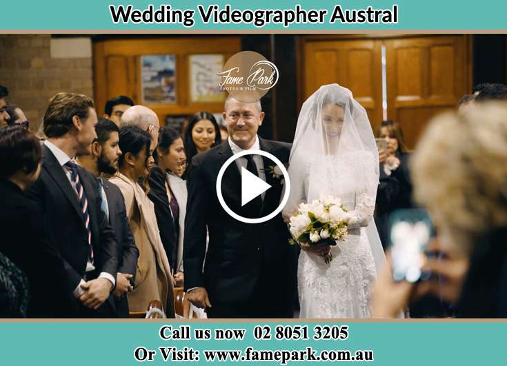 Bride and her father walking at the aisle Austral NSW 2179