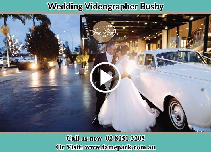 Bride and Groom kissed near the bridal car Busby NSW 2168