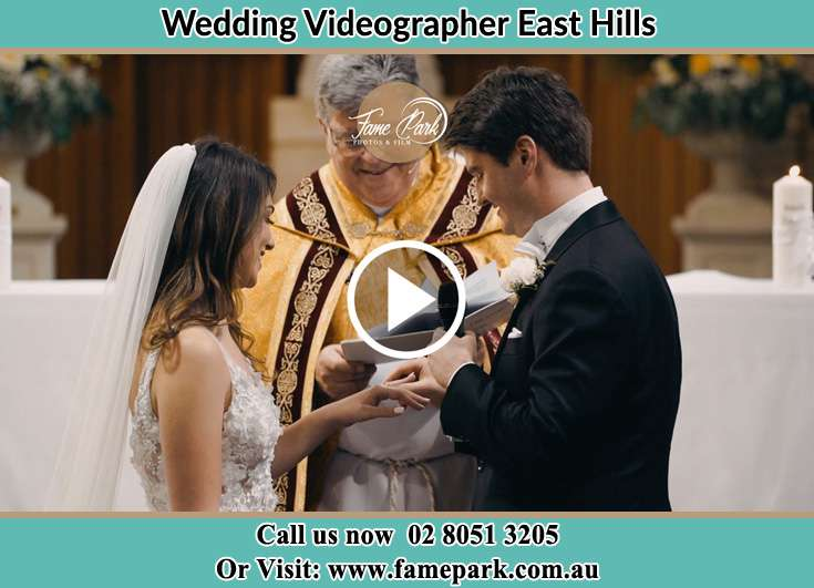 The Groom putting the ring on his Bride's finger during the wedding rites East Hills NSW 2213