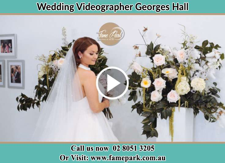 The Bride holding a bouquet of flowers and pose for the camera Georges Hall NSW 2198