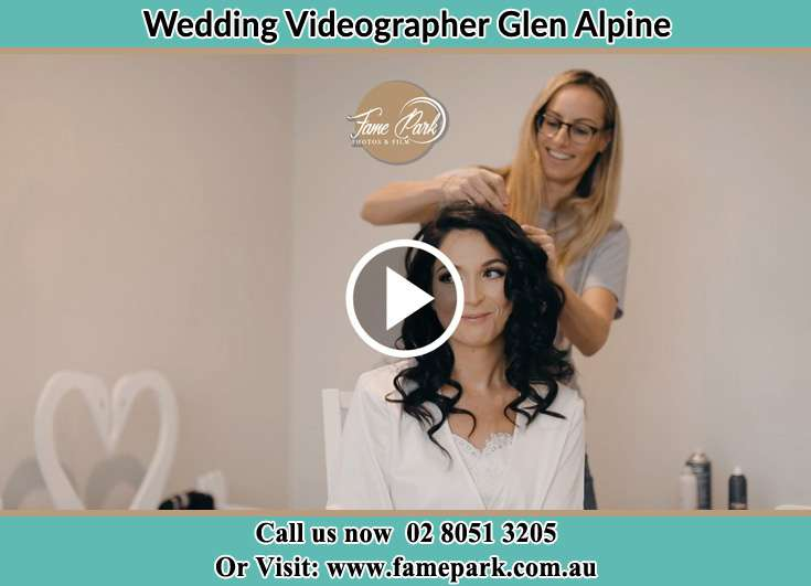A girl fixing the Bride's hair Glen Alpine NSW 2560