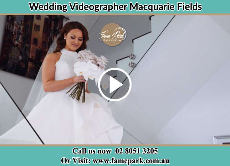 Bride walking down the staircase Macquarie Fields NSW 2564