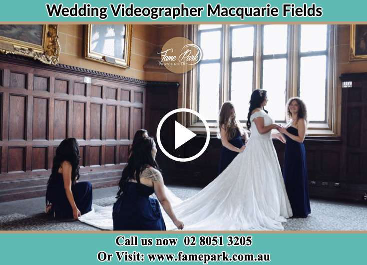 Bride and her secondary sponsors fixing her weddin gown Macquarie Fields NSW 2564