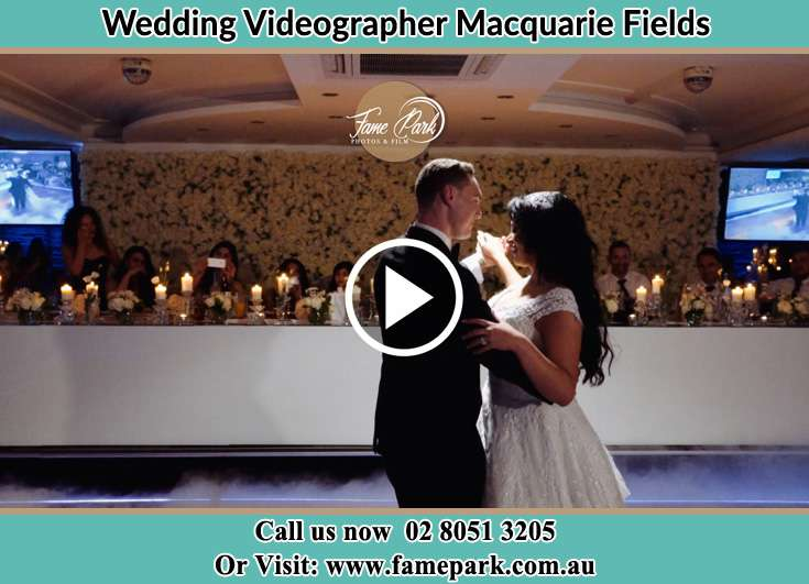 Bride and Groom looking at each other while dancing Macquarie Fields NSW 2564