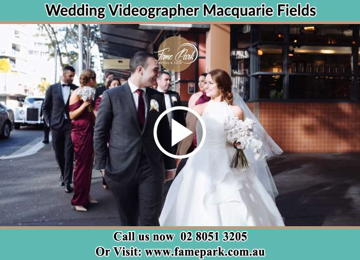 Bride and Groom looking at each other while walking Macquarie Fields NSW 2564