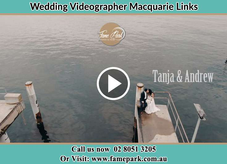 Bride and Groom kissed while sitting at the bay walk Macquarie Links NSW 2565