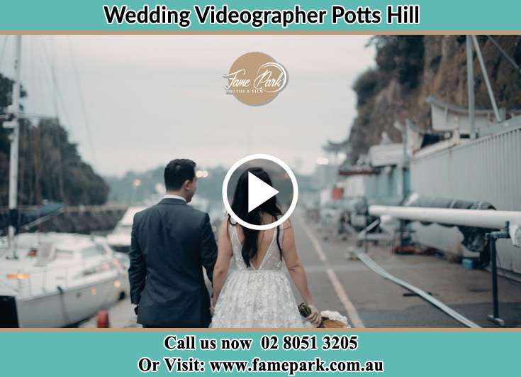 Bride and Groom walking side by side at the harbor Potts Hill NSW 2143