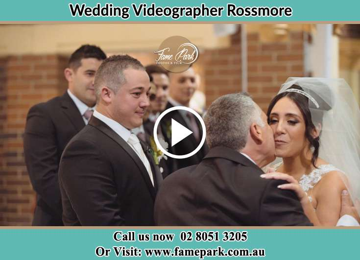 The Bride greeted by her father Rossmore NSW 2557