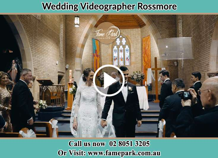 The Groom and the Bride walking out the church Rossmore NSW 2557