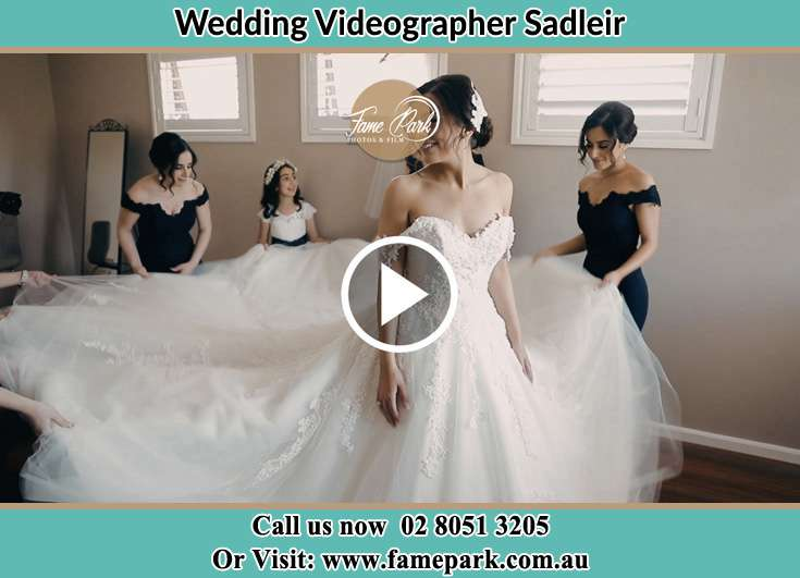 The Bride Assisting by her friend on her wedding gown Sadleir NSW 2168