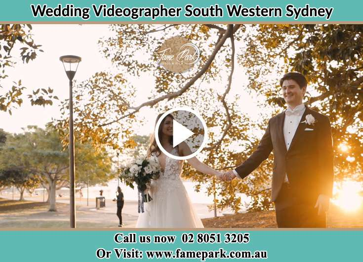 The Bride and the Groom holding hands at the park South Western Sydney