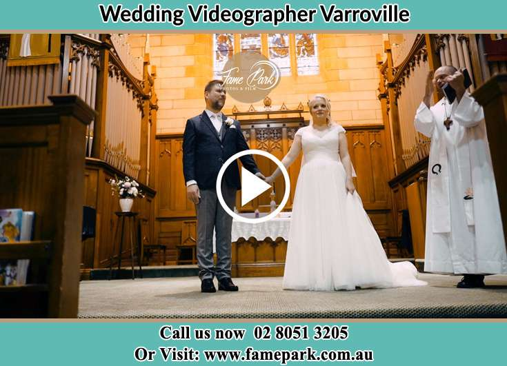 The Bride and the groom holding hands Varroville NSW 2566