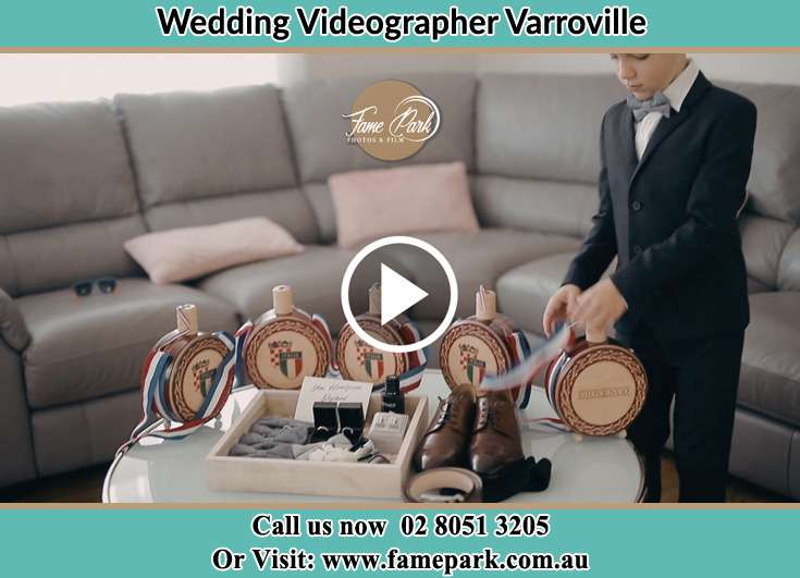 The friend of the groom preparing the things that the groom need on his wedding Varroville NSW 2566