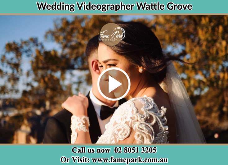 The Bride and the groom holding each other Wattle Grove NSW 2173