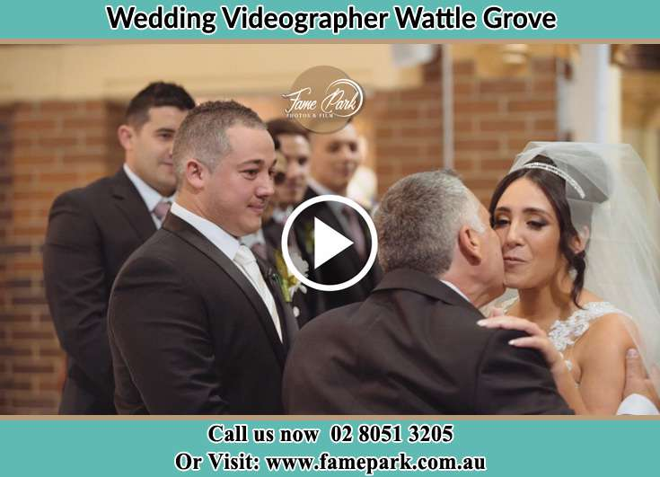 The Bride kissed by her father Wattle Grove NSW 2173