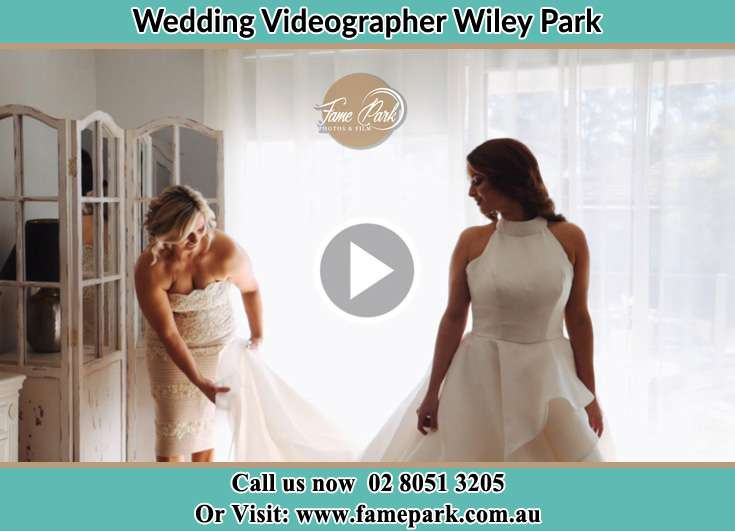 Bride getting her wedding gown fixed Wiley Park NSW 2195